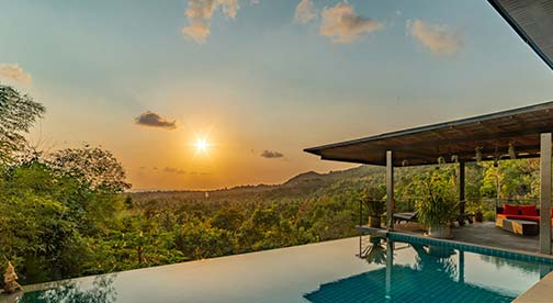 sunset view from a villa for sale in koh phangan